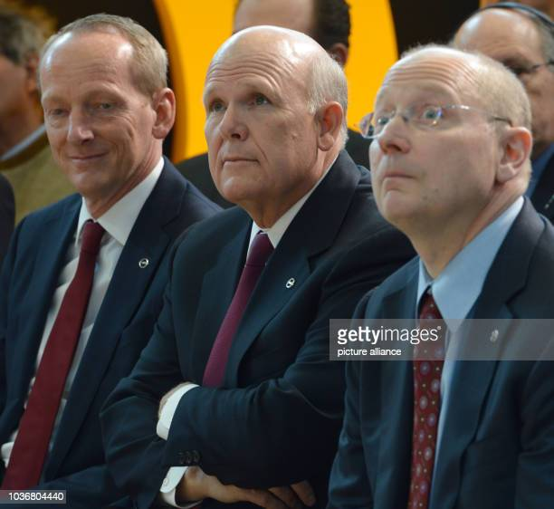 CEO of Adam Opel AG KarlThomas Neumann CEO of General Motors Dan Akerson and chairman of the supervisory board of Opel Steve Girsky look around at...