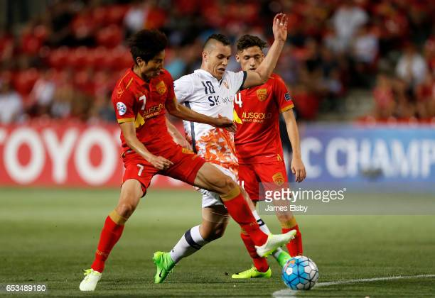 JAESUNG of Adelaide United tackles MARCELO TOSCANO of Jeju United during the AFC Asian Champions League match between Adelaide United and Jeju United...