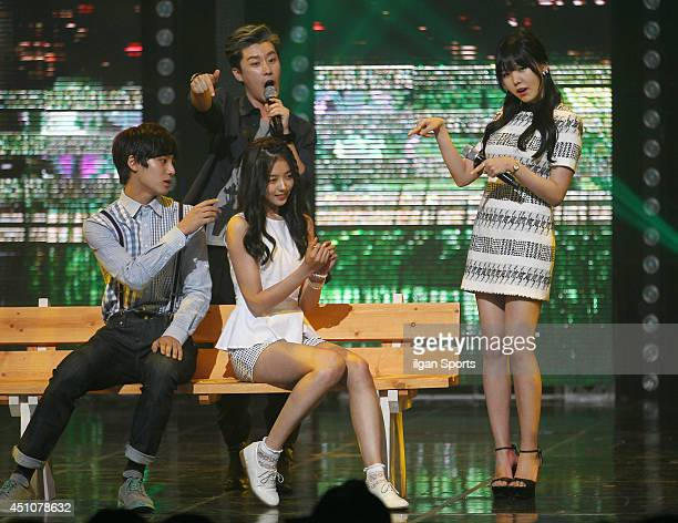 RAINA of After School and San E perform onstage during the Mnet 'M Count Down' at CJ EM Center on June 19 2014 in Seoul South Korea