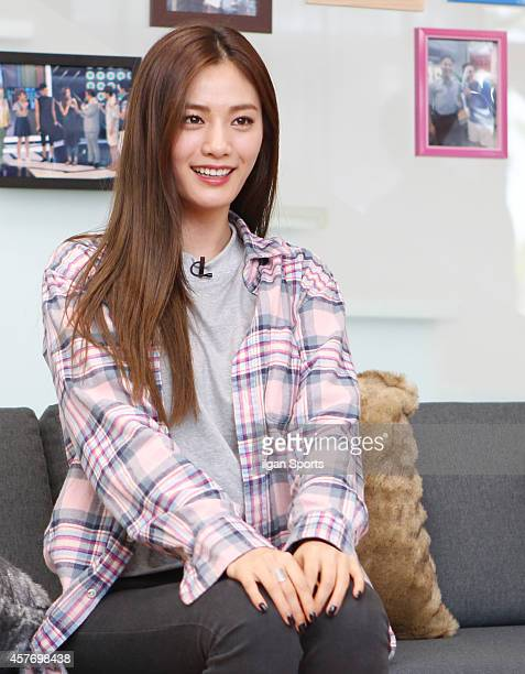 NANA of After School poses for photographs during the SBS 'Roommate 2' press conference at Seongbukdong on October 10 2014 in Seoul South Korea