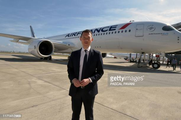CEO of Air France Benjamin Smith poses in front of the company's first Airbus A350 on September 27 2019 at the Airbus delivery center in Colomiers...