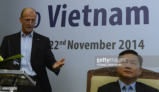 CEO of Airbus Group Tom Enders speaks next to Vietnamese Transport Minister Dinh La Thang during a press conference before boarding an Airbus A350XWB...