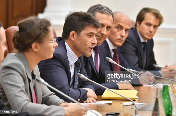 CEO of Airbus Helicopters Bruno Even speaks to Ukraine Prime Minister Volodymyr Groysman before signing a contract in Kiev on July 14 2018 Ukraine...