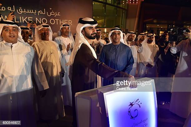 CEO of Al Futtaim Group Omar Al Futtaim looks on as Sheikh Mansoor bin Mohammed Al Maktoum pushes the button to inaugurate the launch of Imagine A...