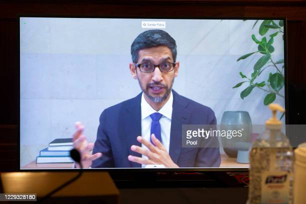 Of Alphabet Inc. And its subsidiary Google LLC, Sundar Pichai, appears on a monitor as he testifies remotely during the Senate Commerce, Science, and...