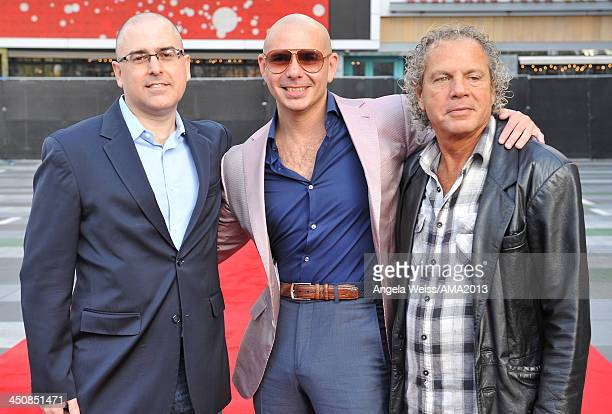 Of Alternative Series & Specials Mark Bracco, recording artist Pitbull and AMA producer Larry Klein attend the 2013 American Music Awards press...