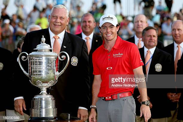 PGA of America President Allen Wronowski poses with Rory McIlroy of Northern Ireland and the Wanamaker Trophy during the Final Round of the 94th PGA...