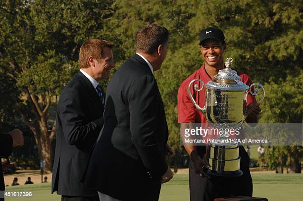 PGA of America President Brian Whitcomb presenting the Wanamaker Trophy to Tiger Woods on 18 green after the Final Round of the 89th PGA Championship...