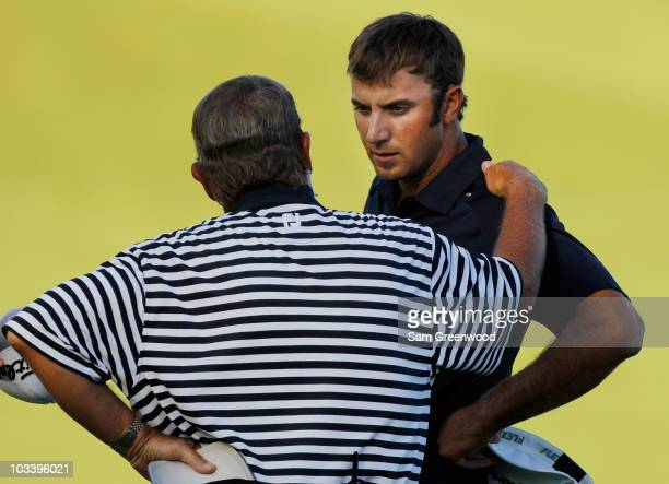 Of America rules official chats with Dustin Johnson on the 18th green during the final round of the 92nd PGA Championship on the Straits Course at...