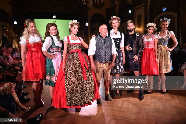 CEO of Angermaier Axel Munz and designer Harald Gloeoeckler with models during 'POMPOEOES By Angermaier Collection Presentation' at Deutsches Theatre...