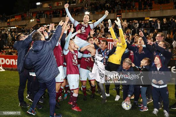 of APIA Leichhardt Tigers players celebrate victory in the FFA Cup round of 16 match between APIA Leichhardt Tigers FC and Melbourne Victory at...