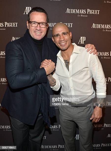 CEO of Audemars Piguet FrancoisHenry Bennahmias and professional boxer Miguel Cotto attend the Opening of Audemars Piguet Rodeo Drive at Audemars...
