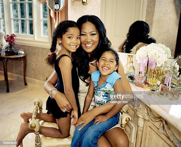 CEO of Baby Phat Kimora Lee Simmons is photographed with daughters Ming Lee and Aoki Lee for Essence Magazine on May 16 2006 at home in Saddle River...