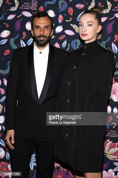 CEO of Balenciaga Cedric Charbit and Mathilde Pinault attend the Harper's Bazaar Exhibition as part of the Paris Fashion Week Womenswear Fall/Winter...