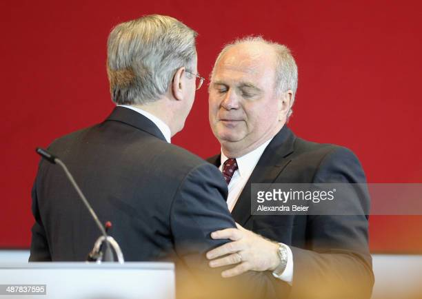 CFO of Bayern Muenchen Karl Hopfner hugs former president Uli Hoeness during the extraordinary members meeting of FC Bayern Muenchen at AudiDome on...