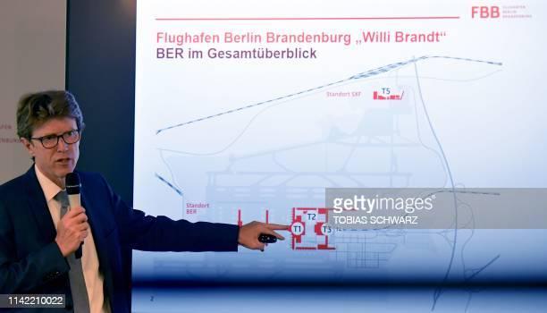 CEO of Berlin Brandenburg Airport Engelbert LuetkeDaldrup gives explanations at the BER Berlin Schoenefeld Airport construction site near Berlin on...