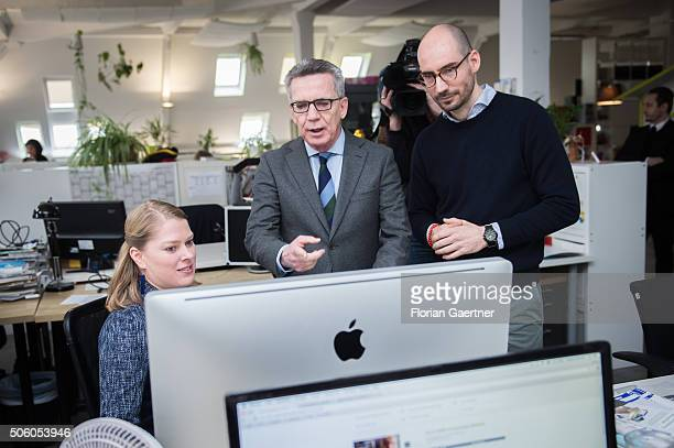 CEO of betterplaceorg Christian Kraus German Interior Minister Thomas de Maiziere and an employee in the office of the digital platform...