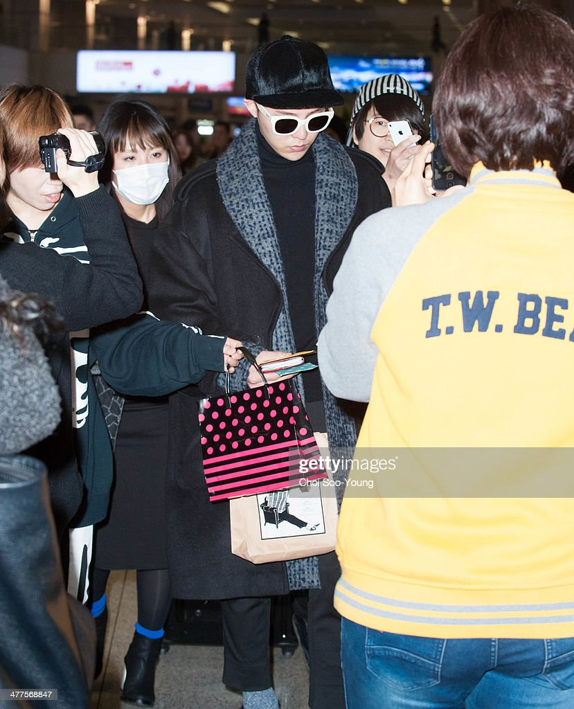 G.DRAGON of BigBang is seen at Incheon International Airport on February 27, 2014 in Incheon, South Korea.