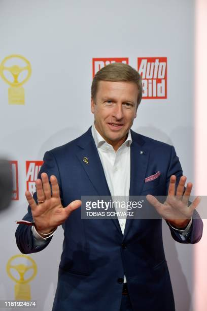 CEO of BMW Oliver Zipse poses on the red carpet as he arrives for the 43rd Goldenes Lenkrad awards on November 12 2019 in Berlin