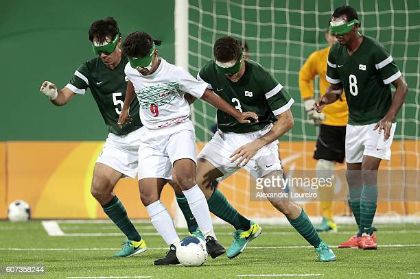 of Brazil fights for the ball with of Iran during the Football 5aside Brazil and Iran Gold Medal Match at Olympic Tennis Centre on day 10 of the Rio...