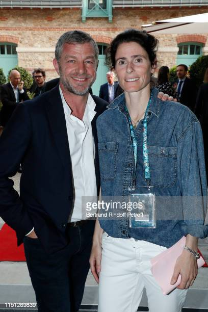 CEO of Cacharel Jacques Bungert and Tennis player Nathalie Dechy attend the 2019 Tennis French Open Women's and Men's Singles Draw at the Orangerie...