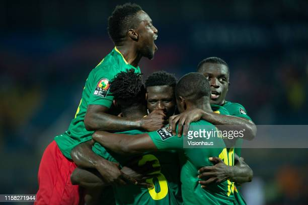 BANANA of Cameroon is congratulated by his team mates after scoring the first goal during the 2019 Africa Cup of Nations Group F match between...