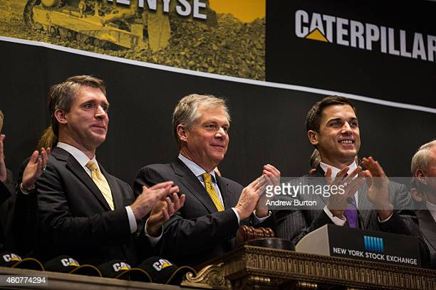 CEO of Caterpillar Inc Doug Oberhelman rings the opening bell of the New York Stock Exchange on December 22 2014 in New York City Caterpillar Inc is...