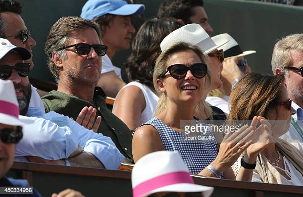 CEO of Colony Capital Sebastien Bazin AnneSophie Lapix attend the men's final of the French Open 2014 held at RolandGarros stadium on June 8 2014 in...