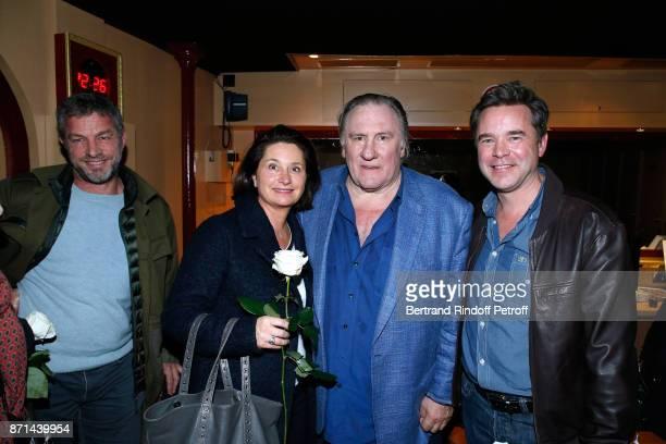 CEO of Courreges Jacques Bungert Christelle de Tonquedec Gerard Depardieu and Guillaume de Tonquedec pose after Depardieu Chante Barbara at Le Cirque...