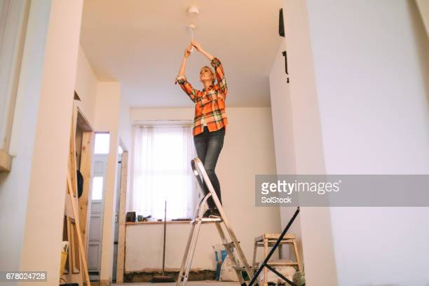Of course she can change a lightbulb