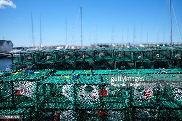 of crab pots at harbor against clear sky - crab pot stock photos and pictures