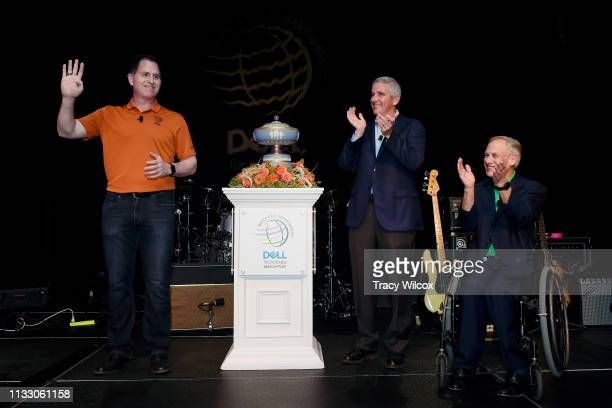 CEO of Dell Technologies Michael Dell holds up four fingers as he addresses a crowd at the Hotel Van Zandt with PGA TOUR Commissioner Jay Monahan and...