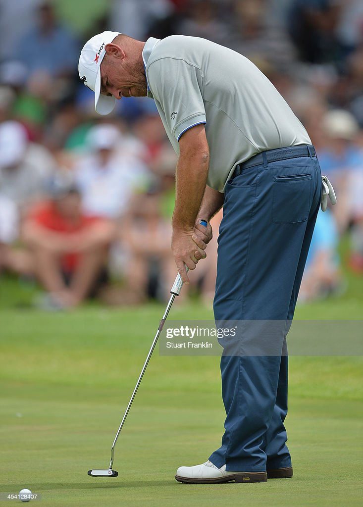 of Denmark putts during the third round of the Nedbank Golf Challenge at Gary Player CC on December 7, 2013 in Sun City, South Africa.