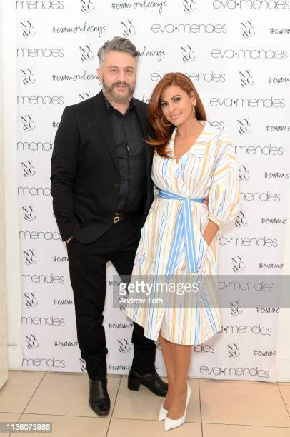 SVP of Design at New York Company Alejandro Blanco poses with Eva Mendes as she visits New York Company Store on March 15 2019 in Burbank California
