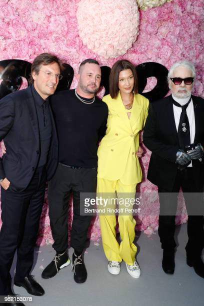CEO of Dior Pietro Beccari Stylist Kim Jones Bella Hadid and Karl Lagerfeld pose after the Dior Homme Menswear Spring/Summer 2019 show as part of...