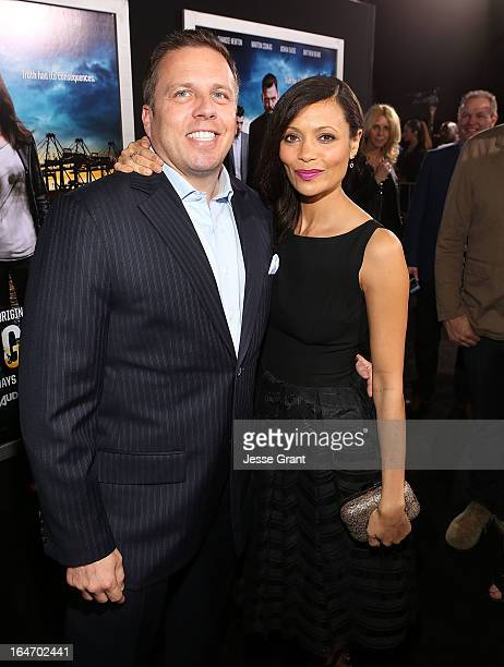 SVP of DirecTV Entertainment Chris Long and actress Thandie Newton attend the Los Angeles Premiere of 'Rogue' at ArcLight Cinemas on March 26 2013 in...