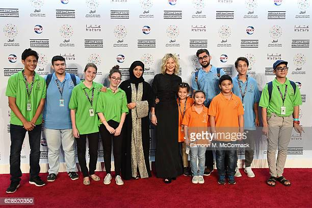CEO of Doha Film Institute Fatma Al Remaihi and Meg Ryan pose with members of the jury at the closing ceremony and screening of 'The Red Turtle'...