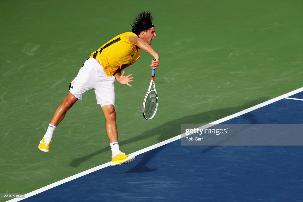 of Dominic Thiem of Austria serves to Adrian Mannarino of France during Day 6 of the Western and Southern Open at the Linder Family Tennis Center on August 17, 2017 in Mason, Ohio.