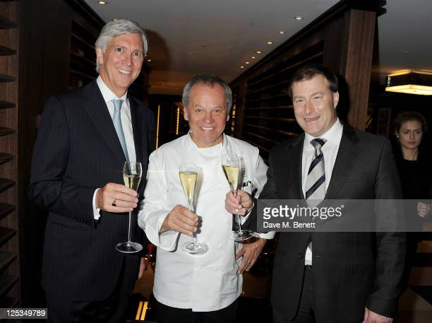 CEO of Dorchester Collection Christopher Cowdray Wolfgang Puck and General Manager of The Dorchester Roland Fasel attend a private dinner hosted by...