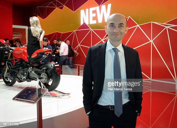 CEO of Ducati Claudio Domenicali poses at Ducati show room during the EICMA 2013 71st International Motorcycle Exhibition on November 6 2013 in Milan...
