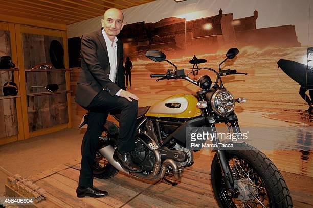 CEO of Ducati Motor Holding Claudio Domenicali pose for a photo during the EICMA 2014 72th International Motorcycle Exhibition on November 4 2014 in...