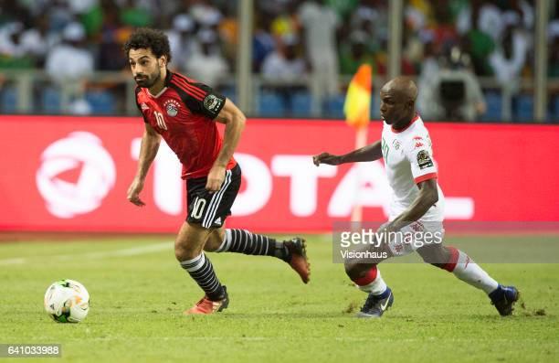 SALAH of Egypt and BENINWENDÉ YANN JONATHAN of Burkina Faso during the semifinal match between Burkina Faso and Egypt at Stade de L'Amitie on...
