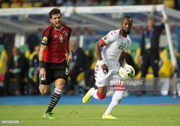 HAMED of Egypt and IBRAHIM BLATI TOURE of Burkina Faso during the semifinal match between Burkina Faso and Egypt at Stade de L'Amitie on February 01...
