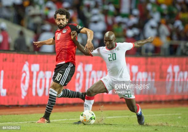 SALAH of Egypt and YACOUBA COULIBALY of Burkina Faso during the semifinal match between Burkina Faso and Egypt at Stade de L'Amitie on February 01...