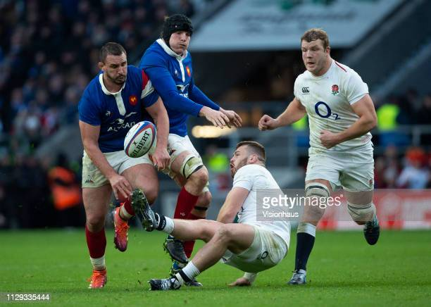 Of England and Louis Picamoles of France during the Guinness Six Nations match between England and France at Twickenham Stadium on February 10, 2019...