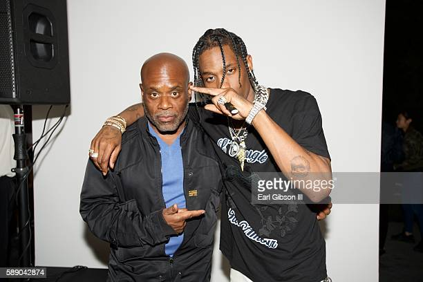 CEO Of Epic Records LA Reid and HipHop Artist Travis Scott pose for a photo at the Travis Scott WAV Party at Kayne Griffin Corcoran Gallery on August...