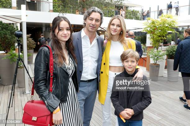 CEO of Facebook France Laurent Solly and his children attend the 2019 French Tennis Open Day Five at Roland Garros on May 30 2019 in Paris France