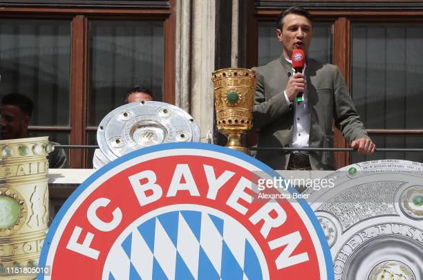 of FC Bayern Muenchen celebrate winning the Bundesliga title and the German Cup title for the season 2018/19 on the balcony of the town hall at...