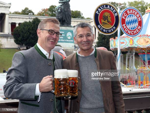 CFO of FC Bayern Muenchen JanChristian Dreesen and former Adidas CEO Herbert Heiner attend the Oktoberfest at Kaefer Wiesenschaenke tent at...