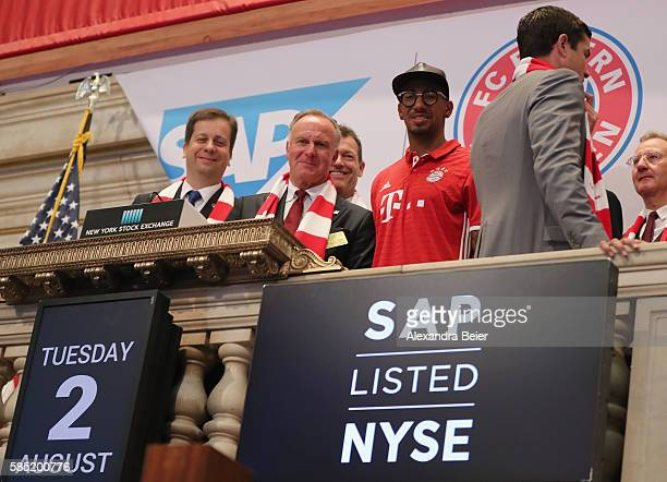 CEO of FC Bayern Muenchen KarlHeinz Rummenigge Jerome Boateng of FC Bayern Muenchen and CFO of SAP SE Luka Mucic smile after they rang the New York...
